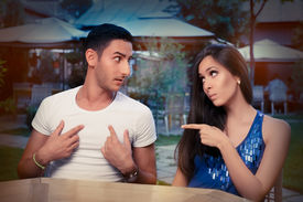 foto of conflict couple  - Young adult couple arguing with funny expressions and gestures - JPG