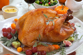 foto of pumpkin pie  - Roasted turkey on a server tray garnished with fresh figs grape kumquat and herbs on fall harvest table. Red wine side dishes pie and gravy. Decoraded with mini pumpkins candels and flowers. ** Note: Soft Focus at 100%, best at smaller sizes - JPG
