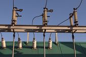 picture of transformer  - green electirical transformer on blue sky bacground - JPG