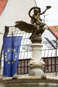 Fountain And Statue Of Golden Boy In Bratislava On The Background Of The Eu Flag