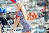 pic of flowing hair  - Beautiful blonde with blue eyes and long flowing hair - JPG
