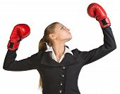 picture of turn-up  - Businesswoman wearing boxing gloves - JPG
