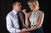 picture of seducing  - attractive woman seduces a man isolated on black background - JPG