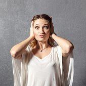Girl in hear no evil pose