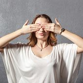 Girl in see no evil pose