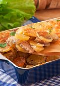 Potato casserole with meat and mushrooms with cheese crust