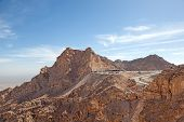 stock photo of jabal  - Jebel Hafeet mountains in the outskirts of Al Ain Emirate of Abu Dhabi UAE - JPG