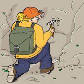 Kneeling Geologist Using Chisel