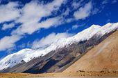 stock photo of blue ridge mountains  - Snow peak high ridge mountains of Ladakh with beautiful blue sky background Jammu and Kashmir India - JPG