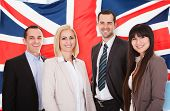image of united we stand  - Group Of Happy Businesspeople Standing In Front Of British Flag - JPG