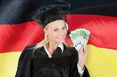 Female Graduate Student Holding Money