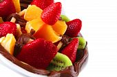 picture of crown green bowls  - exotic fruits in chocolate cream on white bowl - JPG