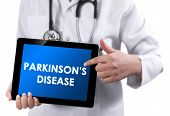 image of gastritis  - Doctor showing tablet with text Parkinsons Disease - JPG