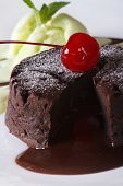 Delicious Chocolate Cake Fondant Close-up On A Plate. Vertical