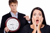 picture of late 20s  - Frightened business woman is late on work - JPG
