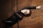 Beautiful Young Woman Lying On The Wooden Steps