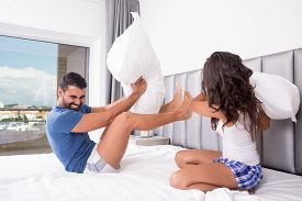 pic of pillow-fight  - Funny couple fighting with pillows in bed - JPG