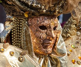 foto of venice carnival  - Golden mask with decorations and carvings during the Carnival of Venice 2015 edition - JPG