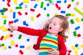 picture of little young child children girl toddler  - Child playing with colorful wooden toys - JPG