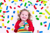 pic of little young child children girl toddler  - Child playing with colorful wooden toys - JPG