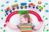 image of daycare  - Child playing with wooden train - JPG