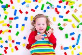 foto of little young child children girl toddler  - Child playing with colorful wooden toys - JPG