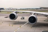 image of aeroplane  - Aeroplane engines at airport on a cloudy day - JPG