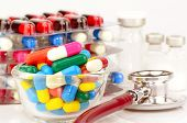 stock photo of oral  - Colorful of oral medications Sterile Vials and Stethoscope on White Background - JPG