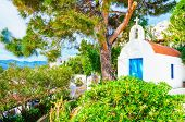 image of greek  - Small white Greek church with blue doors typical for Greek island culture - JPG