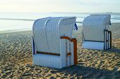 image of roof-light  - Two roofed wicker beach chairs at the baltic sea in the morning light - JPG