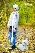 image of west highland white terrier  - girl with west highland terrier in the park - JPG