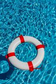 image of crisis  - an emergency tire floating in a pool - JPG