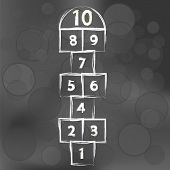 picture of hopscotch  - Hopscotch Game on Dark Blurred Background - JPG
