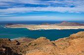 stock photo of canary-islands  - View of Graciosa Island from Mirador del Rio Lanzarote Island Canary Islands Spain - JPG