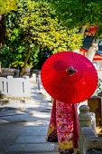 picture of japan girl  - Japanese girl in kimono carrying a red umbrella - JPG