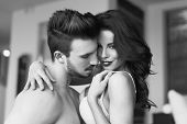 image of foreplay  - Sexy passionate couple foreplay at home   with young lover black and white - JPG