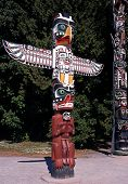 stock photo of totem pole  - Colourful Totem pole in Stanley Park Vancouver British Columbia Canada - JPG