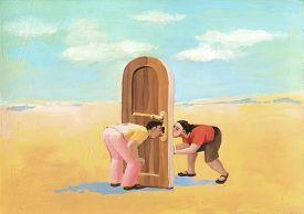 picture of keyholes  - a man and a woman in the desert they look through a keyhole - JPG
