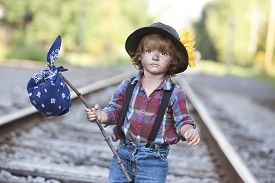 image of hobo  - Adorable toddler on the railroad tracks dressed as a little hobo - JPG