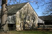 foto of fieldstone-wall  - the trees cast long shadows across this colonial stable