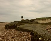 stock photo of rip-rap  - Brandt Point light house - JPG