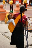 Mother And Child Selling Items In Cozumel Mexico