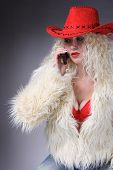 Curly Blonde In A Red Hat And White Fluffy Fur Coat poster
