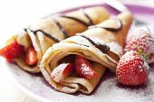 stock photo of crepes  - close up of two french style crepes shallow dof - JPG