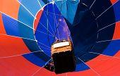 Looking up at colourful hot air balloon