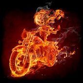 Burning pumpkin riding a motorcycle