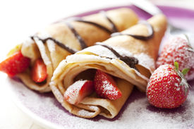 image of crepes  - close up of two french style crepes shallow dof - JPG