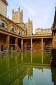image of church-of-england  - Ancient Roman Baths at Bath England at dusk - JPG