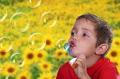 Adorable Child Blowing Soap Bubbles