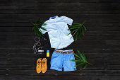 Man Summer Clothes Collage Flat Lay Isolated On Dark Wood Background. Summer Outfit Of Casual Man De poster